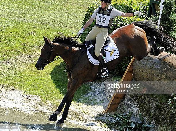 Belgium's Karin Donckers and her horse 'Gazelle de la Brasserie' ride through the water after a jump during the CHIO World Equestrian Festival in...