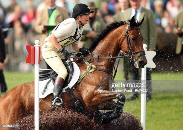 Belgium's Karin Donckers riding Gazelle De La Brasserie jumps through the lake during the cross country competition at the Badminton Horse Trials 2009