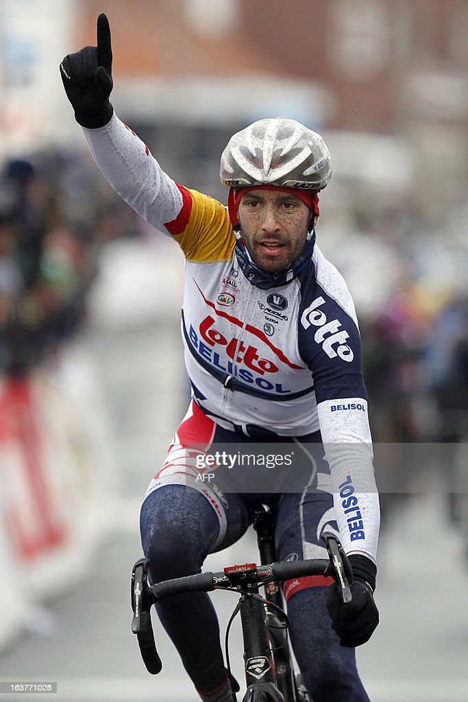 Belgium's Kenny Dehaes of Lotto - Belisol celebrates on March 15, 2013 as he crosses the finish line to win the 'Handzame Classic' cycling race in Handzame, Kortemark.