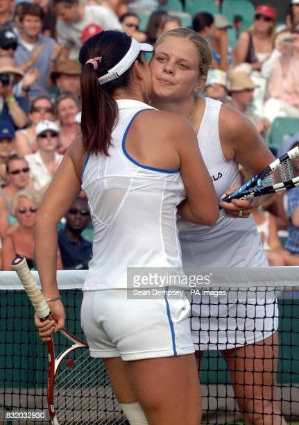 Belgium's Kim Clijsters kisses China's Jie Zheng after her win during the third round of The All England Lawn Tennis Championships at Wimbledon