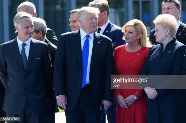 Belgium's King Philip US President Donald Trump Croatian President Kolinda GrabarKitarovic and Lituania's President Dalia Grybauskaite attend the...