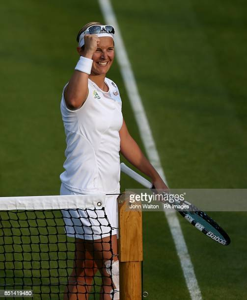 Belgium's Kirsten Flipkens celebrates after victory against Serbia's Bojana Jovanovski during day three of the Wimbledon Championships at The All...