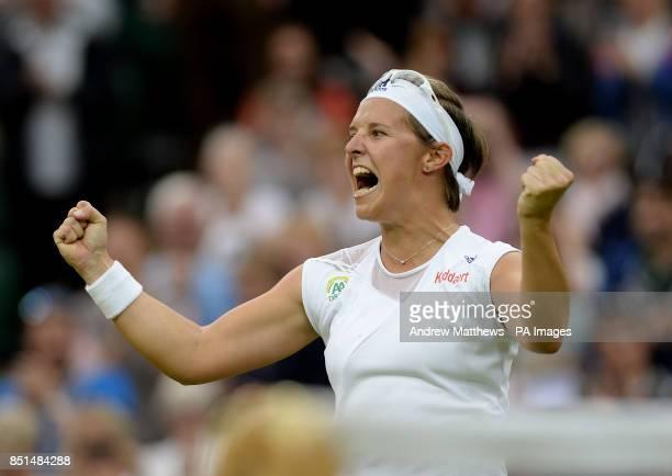 Belgium's Kirsten Flipkens celebrates defeating Czech Republic's Petra Kvitova during day eight of the Wimbledon Championships at The All England...