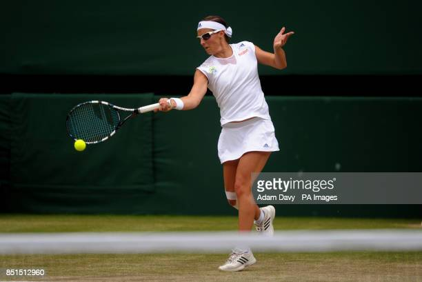 Belgium's Kirsten Flipkens in action against France's Marion Bartoli during day ten of the Wimbledon Championships at The All England Lawn Tennis and...