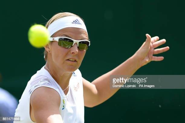 Belgium's Kirsten Flipkens in action against Italy's Flavia Pennetta during day seven of the Wimbledon Championships at The All England Lawn Tennis...