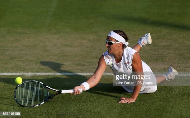 Belgium's Kirsten Flipkens in action against Serbia's Bojana Jovanovski during day three of the Wimbledon Championships at The All England Lawn...