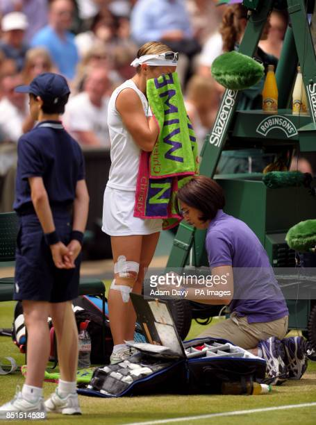 Belgium's Kirsten Flipkens receives a medical time out during her match against France's Marion Bartoli during day ten of the Wimbledon Championships...