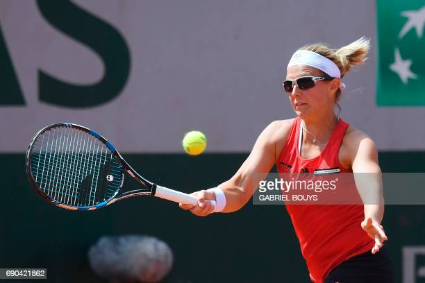 Belgium's Kirsten Flipkens returns the ball to Australia's Samantha Stosur during their tennis match at the Roland Garros 2017 French Open on May 31...