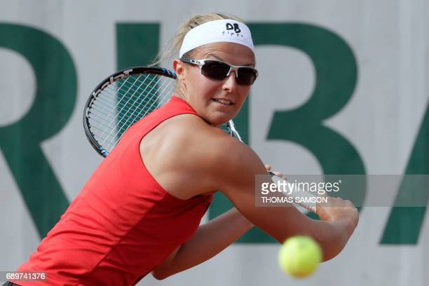 Belgium's Kirsten Flipkens returns the ball to Luxembourg's Mandy Minella during their tennis match at the Roland Garros 2017 French Open on May 29...