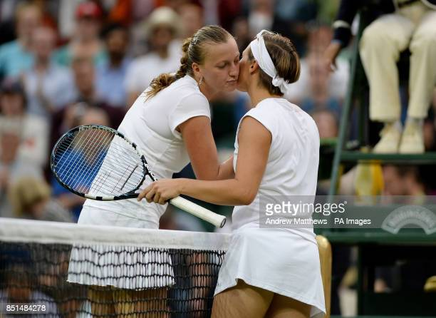 Belgium's Kirsten Flipkens shakes hands with Czech Republic's Petra Kvitova following her win in their match during day eight of the Wimbledon...