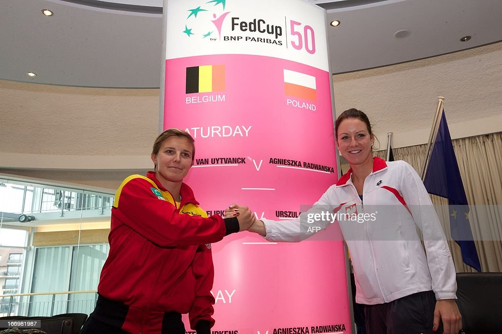 Belgium's Kirsten Flipkens shakes hands with Poland's Urszula Radwanska during the draw for this weekend's Fed Cup World Group II Play-off round match between Poland and Belgium in Koksijde, on April 19, 2013. BELGA