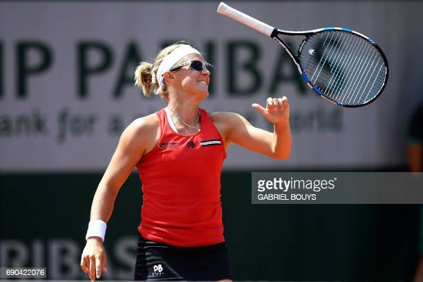 Belgium's Kirsten Flipkens throws her racket during her tennis match against Australia's Samantha Stosur at the Roland Garros 2017 French Open on May...