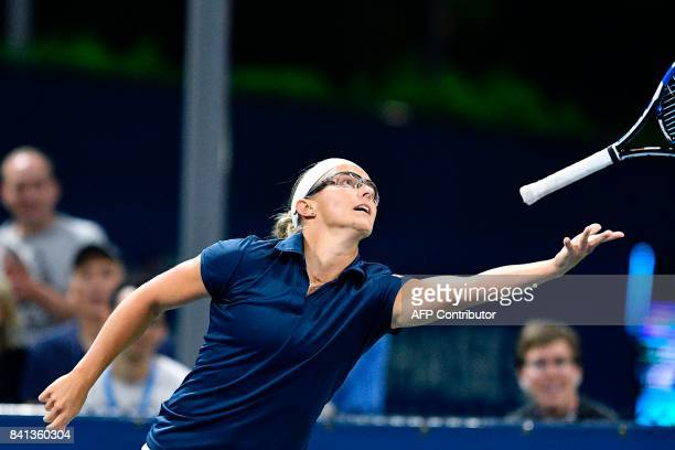 Belgium's Kirsten Flipkens tosses her racket after losing a point against Russia's Elena Vesnina during their 2017 US Open Women's Singles match at...