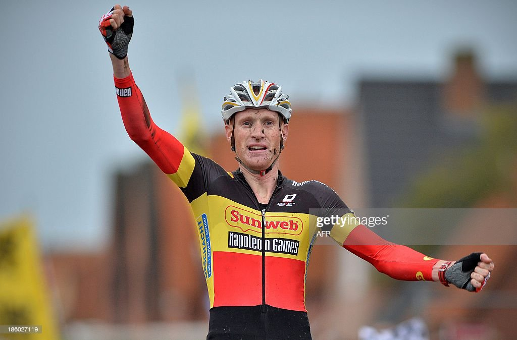 Belgium's Klaas Vantornout celebrates as he crosses the finish-line to win the first stage of the Superprestige cyclocross cycling competition on October 27, 2013 in Ruddervoorde, Oostkamp. AFP PHOTO/ BELGA/ DAVID STOCKMAN == BELGIUM OUT ==