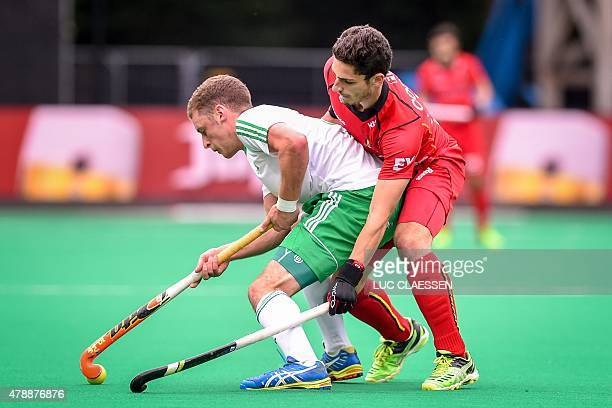 Belgium's Loick Luypaert vies with an Irish player during the Group B field hockey match between Belgium and Ireland of the men's group stage at the...