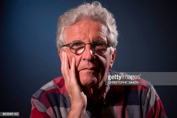 Belgium's Magnum photographer Harry Gruyaert poses during a photo session on September 25 2017 in Paris / AFP PHOTO / CHRISTOPHE SIMON