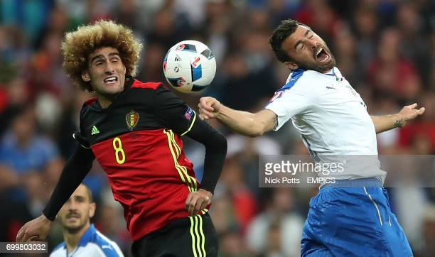 Belgium's Marouane Fellaini and Italy's Andrea Barzagli battle for the ball in the air