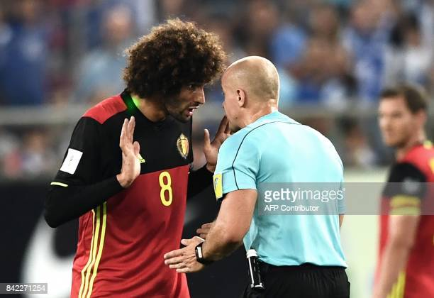 Belgium's Marouane Fellaini gestures as he complains to Polish referee Szymon Marciniak during their Group H 2018 FIFA World Cup qualifying football...