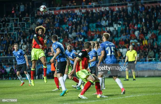 Belgium's Marouane Fellaini heads the ball during the FIFA World Cup 2018 qualification football match between Estonia and Belgium in Tallinn on June...