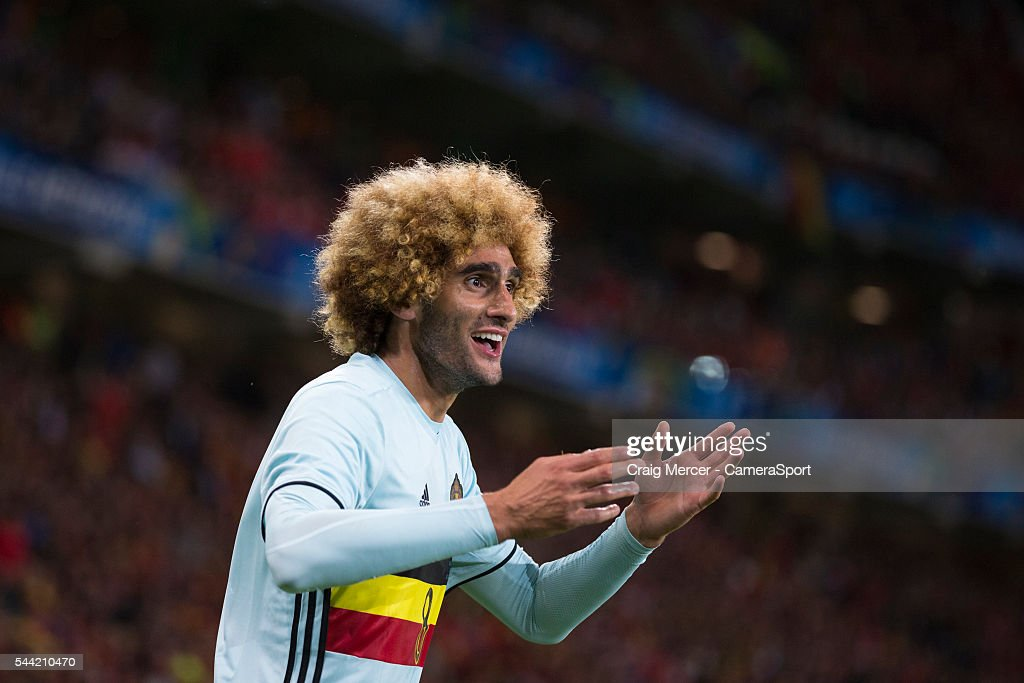 Belgium's <a gi-track='captionPersonalityLinkClicked' href=/galleries/search?phrase=Marouane+Fellaini&family=editorial&specificpeople=3936316 ng-click='$event.stopPropagation()'>Marouane Fellaini</a> reacts during the UEFA Euro 2016 Quarter-final match between Wales and Belgium at Stade Pierre Mauroy on July 01 in Marseille, France.