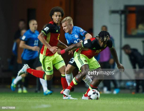Belgium's Michy Batshuayi vies with Estonia's Taijo Teniste during the FIFA World Cup 2018 qualification football match between Estonia and Belgium...