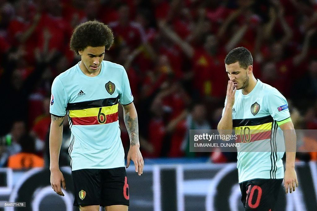 Belgium's midfielder Axel Witsel and Belgium's forward Eden Hazard react after the Euro 2016 quarter-final football match between Wales and Belgium at the Pierre-Mauroy stadium in Villeneuve-d'Ascq near Lille, on July 1, 2016. Wales won the match 3-1. / AFP / EMMANUEL
