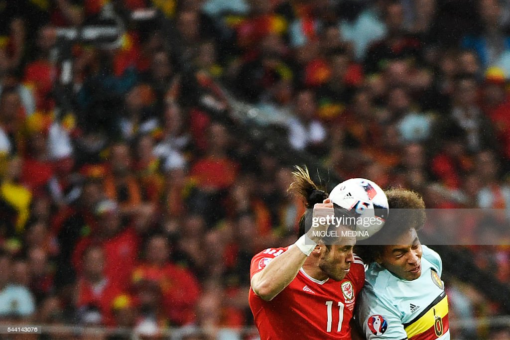 Belgium's midfielder Axel Witsel (R) heads the ball with Wales' forward Gareth Bale during the Euro 2016 quarter-final football match between Wales and Belgium at the Pierre-Mauroy stadium in Villeneuve-d'Ascq near Lille, on July 1, 2016. / AFP / MIGUEL