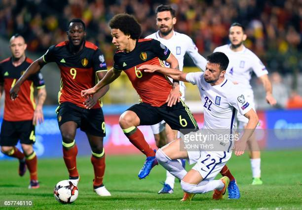 Belgium's midfielder Axel Witsel vies with Greece's Andreas Samaris during the FIFA World Cup 2018 qualification football match between Belgium and...