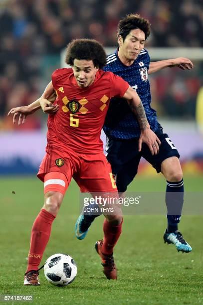 Belgium's midfielder Axel Witsel vies with Japan's forward Genki Haraguchi during the friendly football match Belgium vs Japan on November 14 2017 in...