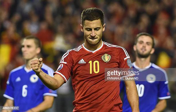 Belgium's midfielder Eden Hazard celebrates after scoring a penalty during the Euro 2016 qualifying match between Belgium and Bosnia and Herzegovina...