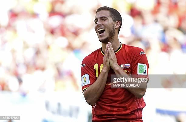 Belgium's midfielder Eden Hazard gestures during a Group H football match between Belgium and Russia at the Maracana Stadium in Rio de Janeiro during...