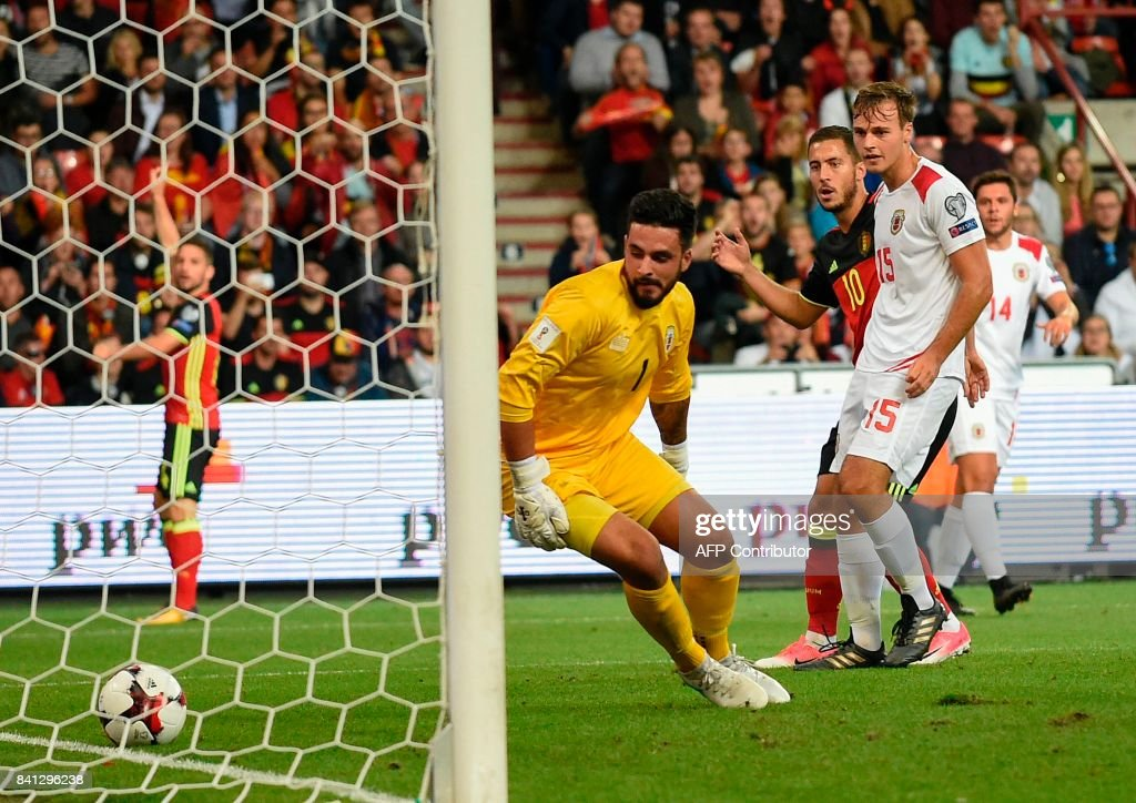 Belgium's midfielder Eden Hazard (Rear R) scores a goal during the WC 2018 football qualification football match between Belgium and Gibraltar, at the Dufrasne Stadium, on August 31, 2017 in Sclessin. /