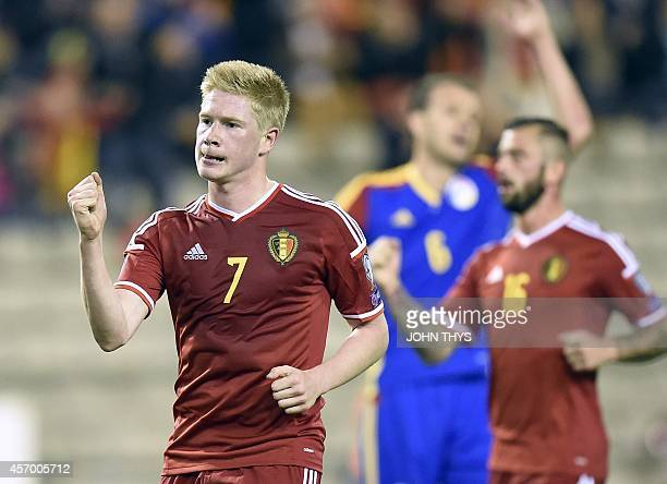 Belgium's midfielder Kevin De Bruyne celebrates after scoring a penalty during the Euro 2016 qualifying round football match between Belgium and...
