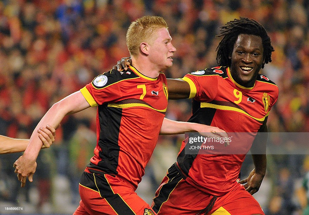 Belgium's midfielder Kevin De Bruyne (L) celebrates with a teammate after scoring during the 2014 World Cup Group G qualifying football match between Belgium and Wales at King Baudouin stadium in Brussels on October 15, 2013.