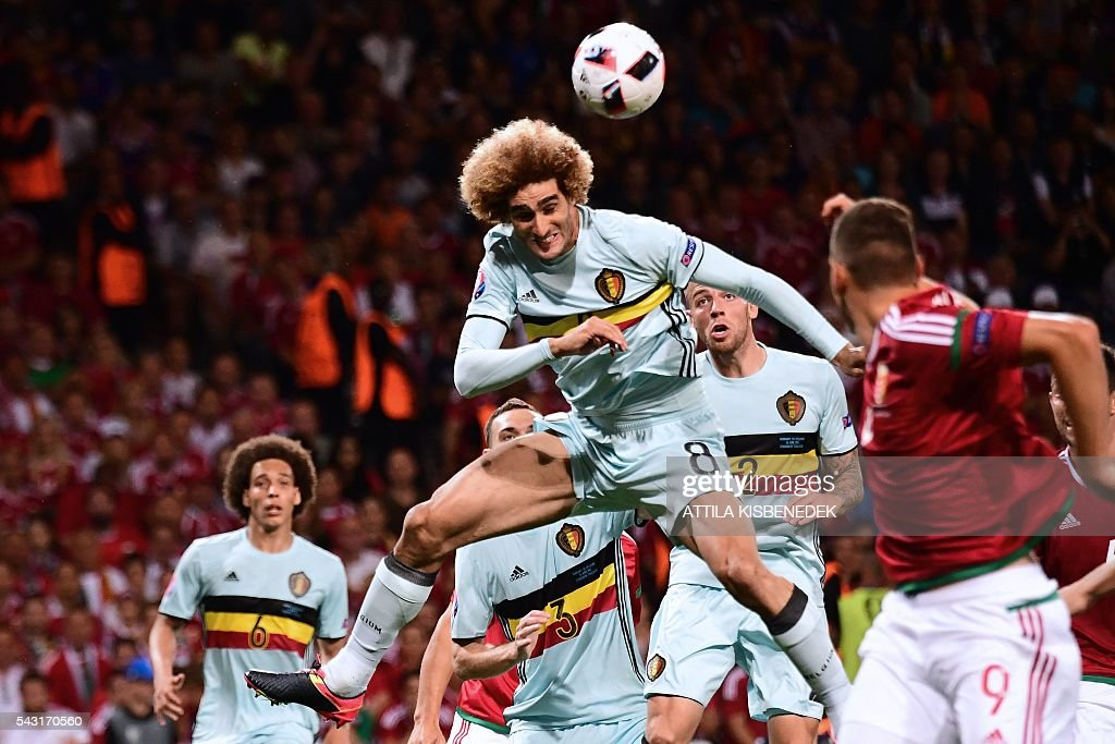 Belgium's midfielder Marouane Fellaini (C) jumps for the ball during the Euro 2016 round of 16 football match between Hungary and Belgium at the Stadium Municipal in Toulouse on June 26, 2016. / AFP / ATTILA