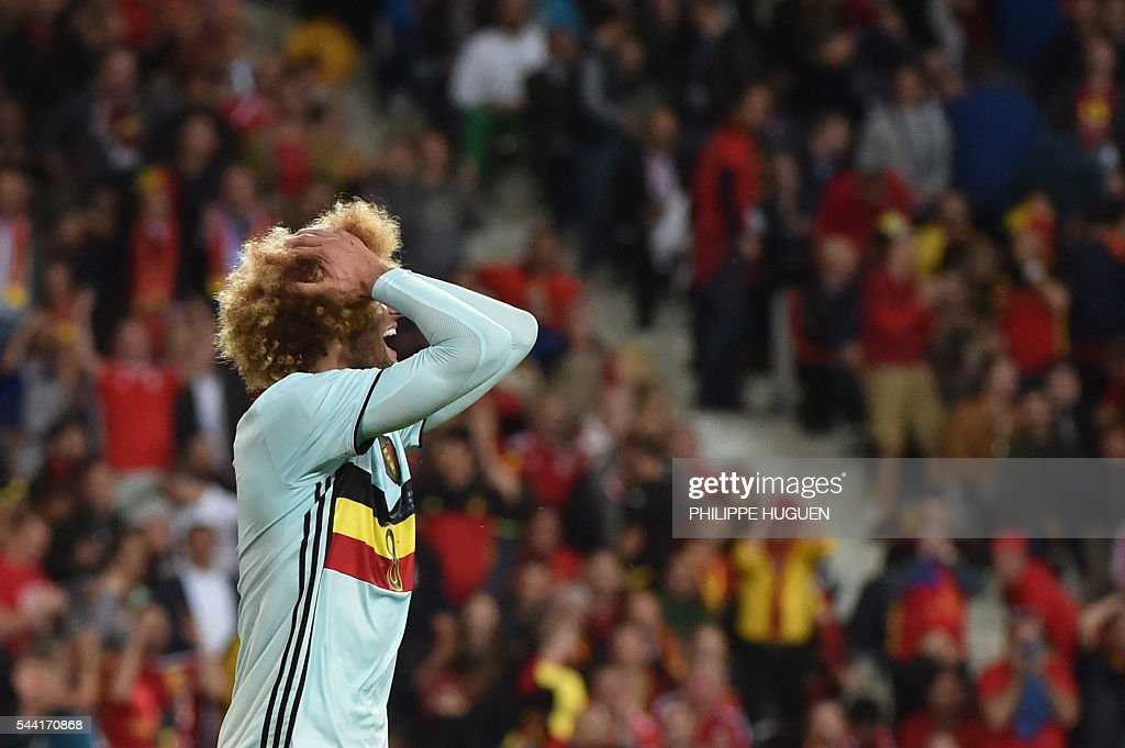 Belgium's midfielder Marouane Fellaini reacts after missing a goal opportunity during the Euro 2016 quarter-final football match between Wales and Belgium at the Pierre-Mauroy stadium in Villeneuve-d'Ascq near Lille, on July 1, 2016. / AFP / PHILIPPE
