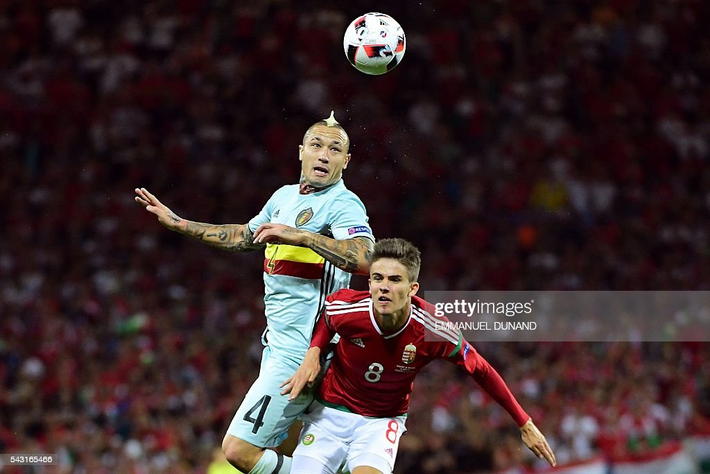 Belgium's midfielder Radja Nainggolan (L) jumps for the ball Hungary's midfielder Adam Nagy during the Euro 2016 round of 16 football match between Hungary and Belgium at the Stadium Municipal in Toulouse on June 26, 2016. / AFP / EMMANUEL