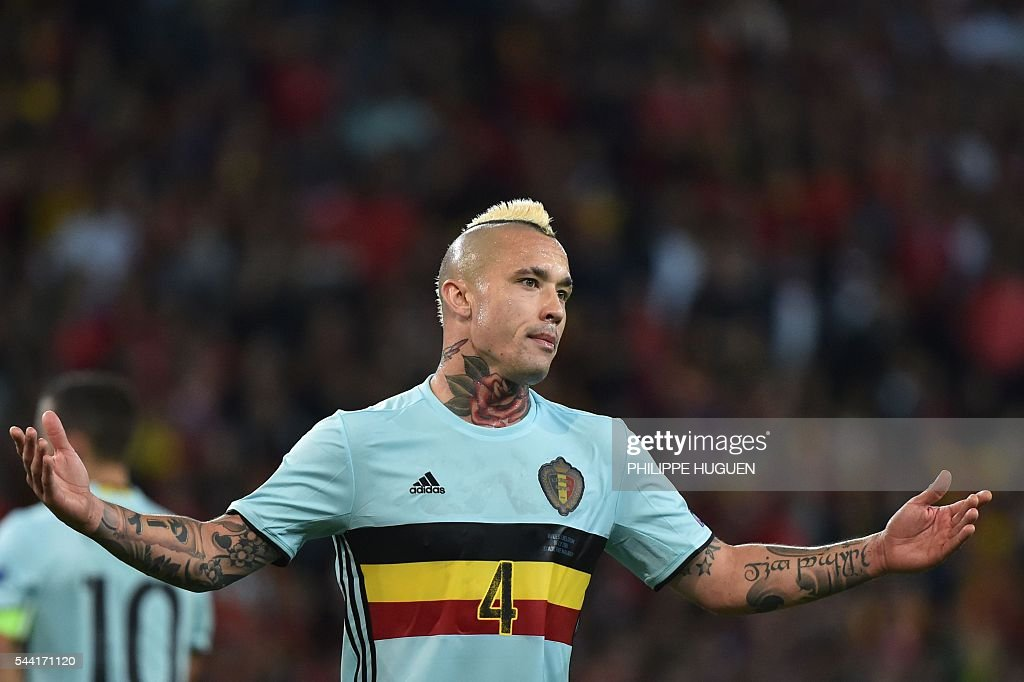 Belgium's midfielder Radja Nainggolan reacts during the Euro 2016 quarter-final football match between Wales and Belgium at the Pierre-Mauroy stadium in Villeneuve-d'Ascq near Lille, on July 1, 2016. / AFP / PHILIPPE