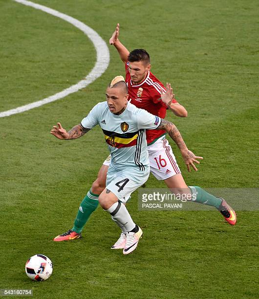 Belgium's midfielder Radja Nainggolan vies for the ball with Hungary's midfielder Adam Pinter during the Euro 2016 round of 16 football match between...