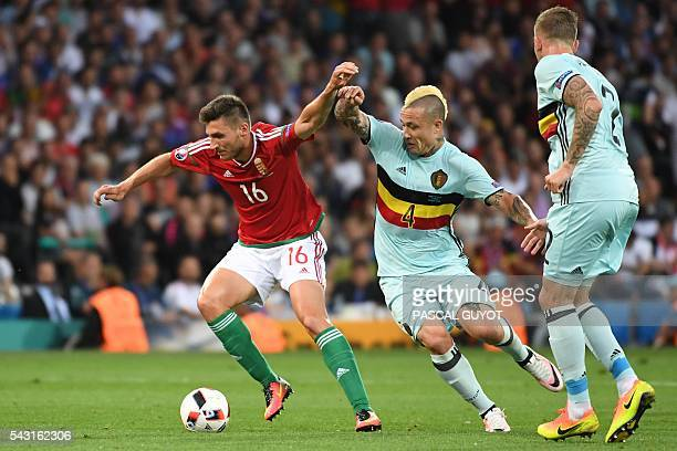 Belgium's midfielder Radja Nainggolan vies for the ball with Hungary's midfielder Adam Pinter during the Euro 2016 round of 16 football match between...