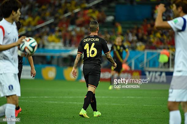 Belgium's midfielder Steven Defour leaves the pitch after receiving a red card during a Group H football match between South Korea and Belgium at the...