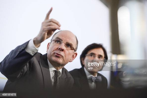 Belgium's Minister of Finance Koen Geens and Belgium Prime Minister Elio Di Rupo attend a press conference after a Kern meeting a restricted...