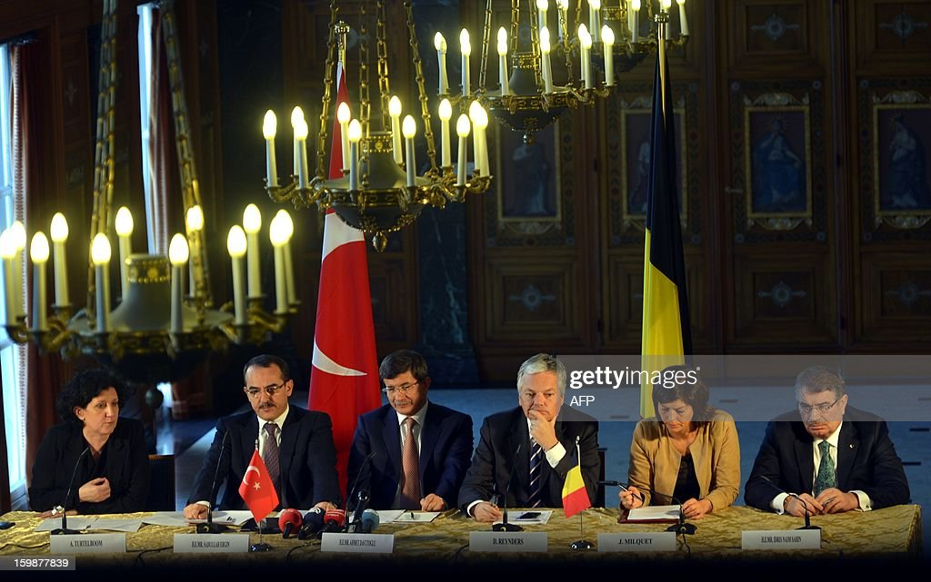 belgium's Minister of Justice Annemie Turtelboom, Turkish Justice Minister Sadullah Ergin, Turkish Foreign Minister Ahmet Davutoglu, Vice-Prime Minister and Foreign Minister Didier Reynders, Vice-Prime Minister and Interior inister Joelle Milquet and Turkish Interior Minister Idris Naim Sahin pictured during a meeting of Turkish and Belgian officials to discuss subjects of joint interest on January 22, 2013 at the Egmont Palace (Egmontpaleis - Palais d'Egmont) in Brussels. AFP PHOTO / BELGA - ERIC LALMAND
