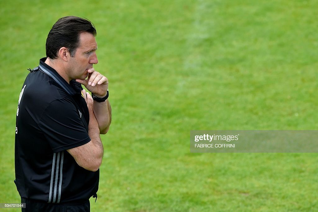 Belgium's national football team coach Marc Wilmots is pictured during a training session on the eve of the friendly match Switzerland vs Belgium on May 27, 2016 in Lausanne. The Belgian team is in Lausanne for a training camp in preparation for the UEFA Euro 2016 football championship in France. / AFP / FABRICE