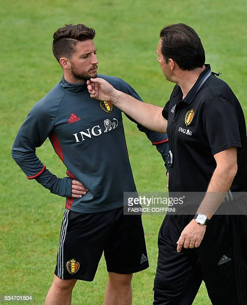 Belgium's national football team coach Marc Wilmots speaks with his player Dries Mertens during a training session on the eve of the friendly match...