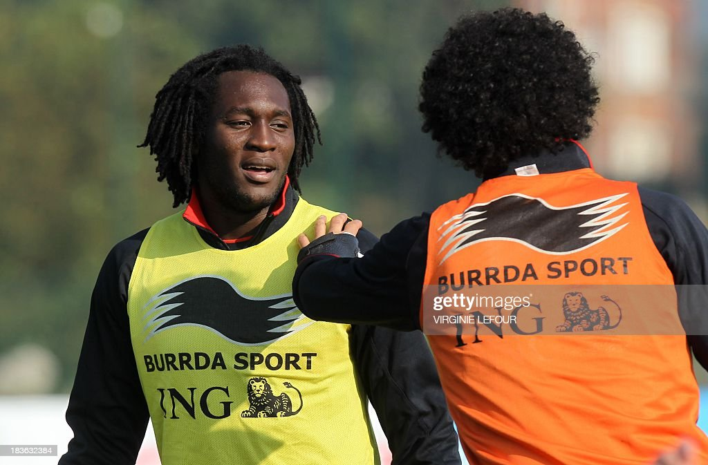 Belgium's national football team Romelu Lukaku (L) and Belgium's Marouane Fellaini attend a training session of the Red Devils in Neerpede, Brussels, on October 8, 2013. The Red Devils will play a qualification game in Croatia for the 2014 FIFA World Cup on October 11.