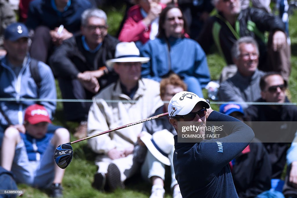 Belgium's Nicolas Colsaerts plays off the 9th tee during the first round of the 100th French Golf Open on July 30, 2016 at Le Golf National in Guyancourt, near Paris. / AFP / DOMINIQUE