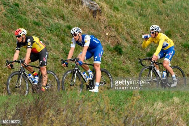 Belgium's Philippe Gilbert Germany's Marcel Kittel and France's Julian Alaphilippe wearing the overall leader's yellow jersey ride in the pack during...