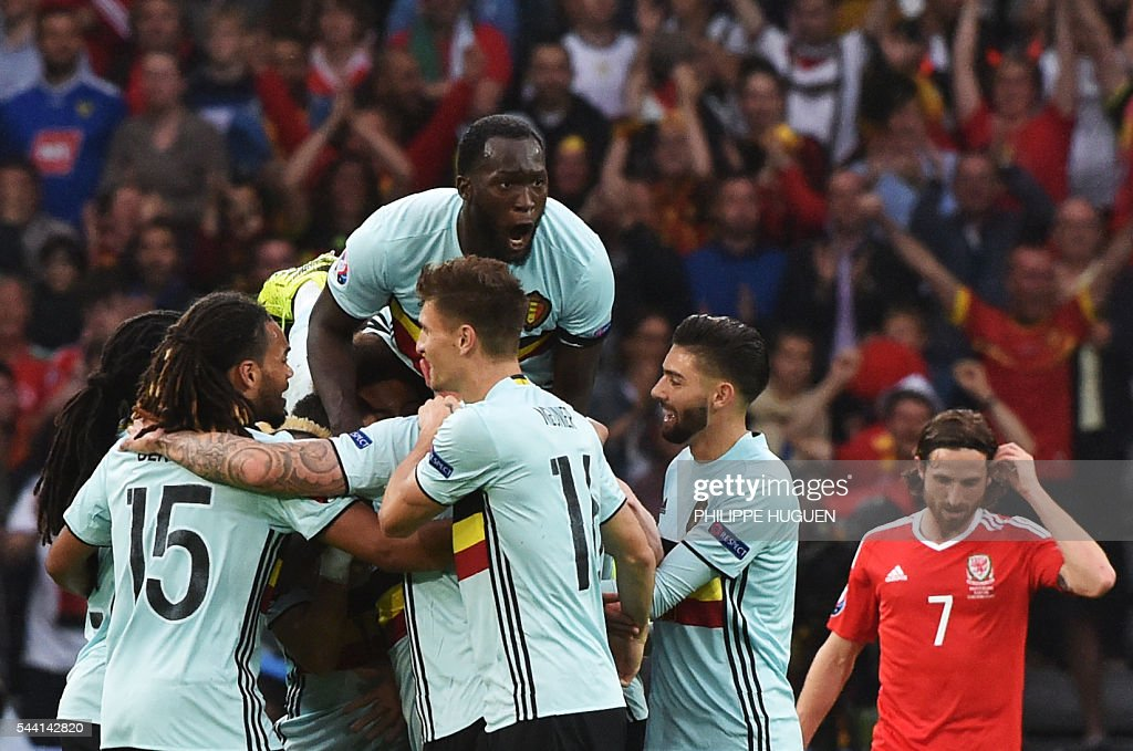 Belgium's players celebrate after scoring a goal during the Euro 2016 quarter-final football match between Wales and Belgium at the Pierre-Mauroy stadium in Villeneuve-d'Ascq near Lille, on July 1, 2016. / AFP / PHILIPPE