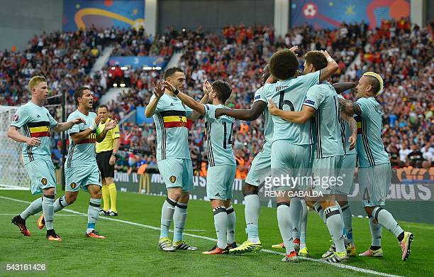 Belgium's players celebrate their opening goal during the Euro 2016 round of 16 football match between Hungary and Belgium at the Stadium Municipal...